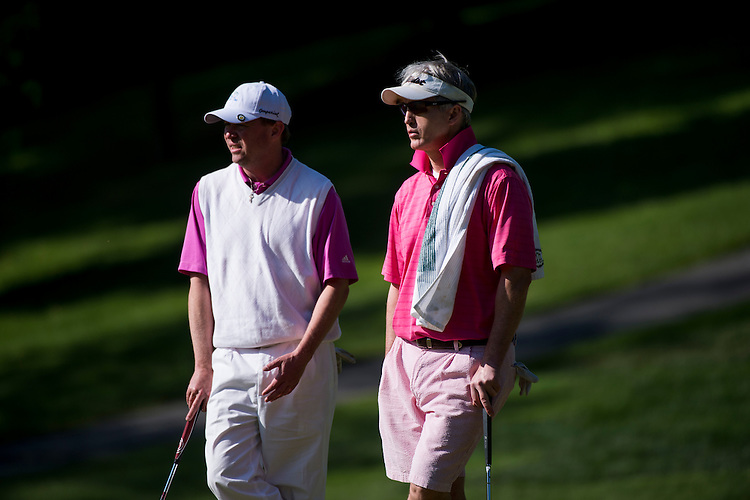 UNITED STATES - MAY 19: Rep. Mick Mulvaney, R-S.C., left, and Rep. Trey Gowdy, R-S.C., watch their opponents putt during the First Tee Congressional Challenge golf tournament at the Columbia Country Club in Chevy Chase, Md., on Monday morning, May 19, 2014. (Photo By Bill Clark/CQ Roll Call)