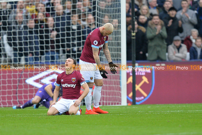 Mark Noble of West Ham United misses a early chance during West Ham United vs Arsenal, Premier League Football at The London Stadium on 12th January 2019