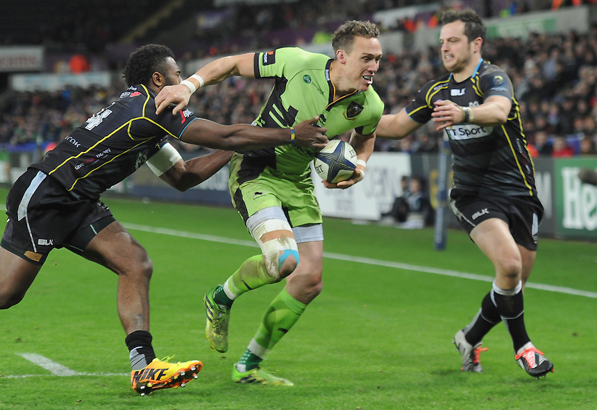 Northampton Saints James Wilson is tackled by Ospreys Aisea Natoga<br /> <br /> Photographer Craig Thomas/CameraSport<br /> <br /> Rugby Union - European Rugby Champions Cup - Pool 5 - Ospreys v Northampton Saints - Sunday 18th January 2015 - Liberty Stadium - Swansea<br /> <br /> &copy; CameraSport - 43 Linden Ave. Countesthorpe. Leicester. England. LE8 5PG - Tel: +44 (0) 116 277 4147 - admin@camerasport.com - www.camerasport.com