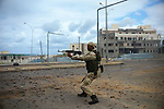 Sirte, LIBYA: Monday 11th October 2011:..Rebel fighters are advancing street by street in a fierce battle for the Libyan city of Sirte. Once rebels capture Sirte,  Gaddafi's hometown, the National Transitional Council (NTC) say they will declare national liberation, even if Col Gaddafi remains at large...Ayman Oghanna