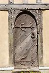 Old wooden door church of All Saints, Crowfield, Suffolk, England, UK