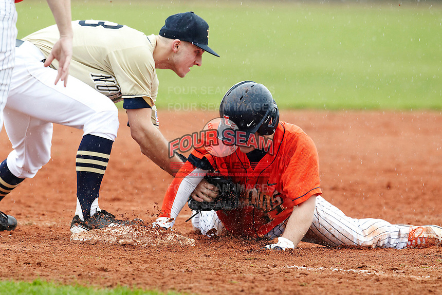Illinois Fighting Illini infielder Michael Hurwitz #11 slides into third as Phil Mosey #33 attempts to tag him during a game against the Notre Dame Fighting Irish at the Big Ten/Big East Challenge at Walter Fuller Complex on February 17, 2012 in St. Petersburg, Florida.  (Mike Janes/Four Seam Images)