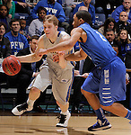 SIOUX FALLS, SD - MARCH 11:  Nate Wolters #3 of South Dakota State drives into Pierre Bland #2 of IPFW during their semi-final game at the 2013 Summit League Basketball Championships Monday at the Sioux Falls Arena.  (Photo by Dick Carlson/Inertia)
