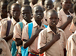 Students place their hands over their hearts as they sing the national anthem at the beginning of the school day at the Loreto Primary School outside Rumbek, South Sudan. The school is run by the Institute for the Blessed Virgin Mary--the Loreto Sisters--of Ireland.