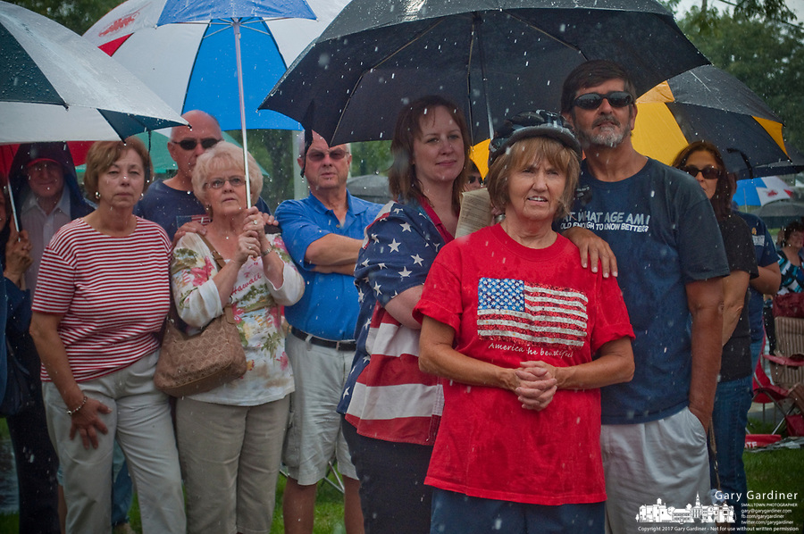 The crowd gathers under umbrellas and in the rain at First Responders Park in Westerville, OH, for ceremonies marking the 10th anniversary of the attack on the World Trade Center