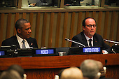 United States President Barack Obama attends a meeting of the Open Government Partnership at the United Nations 69th General Assembly at U.N. Headquarters in New York, New York on Wednesday, September 24, 2014. At right is President François Hollande of France.<br /> Credit: Allan Tannenbaum / Pool via CNP