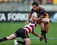 Wellington winger Hosea Gear tries to beat the tackle of Mark Selwyn. ITM Cup - Wellington Lions v Counties-Manukau Steelers at Westpac Stadium, Wellington, New Zealand on Sunday, 8 August 2010. Photo: Dave Lintott/lintottphoto.co.nz.