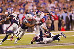 New York Giants wide receiver Hakeem Nicks (88) carries the ball after a reception is gang tackled by the New England Patriots defense during the NFL Super Bowl XLVI football game on Sunday, Feb. 5, 2012, in Indianapolis. The Giants won 21-17 (AP Photo/David Stluka)...
