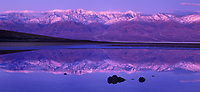 915000001 panorama view of  sunrise on badwater and the panamint mountains in death valley national park california