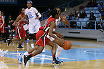 13 November 2015: Gardner-Webb's Candace Brown (22) drives past North Carolina's Erika Johnson (31) to score the game-winning shot. The University of North Carolina Tar Heels hosted the Gardner-Webb University Runnin' Bulldogs at Carmichael Arena in Chapel Hill, North Carolina in a 2015-16 NCAA Division I Women's Basketball game. Gardner-Webb won the game 66-65.