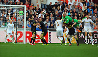 Saturday, 20 October 2012<br /> Pictured: Ali Al Habsi, goalkeeper for Wigan heads the ball off target from a Wigan cross<br /> Re: Barclays Premier League, Swansea City FC v Wigan Athletic at the Liberty Stadium, south Wales.