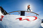 Snowboarder slides rail at Blackcomb park in Whistler, BC.