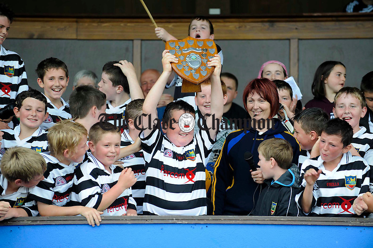 Clarecastle captain Dean O Hara collects the trophy following their win over Feakle/Killanena  during their U-12B final at Cusack Park. Photograph by John Kelly.