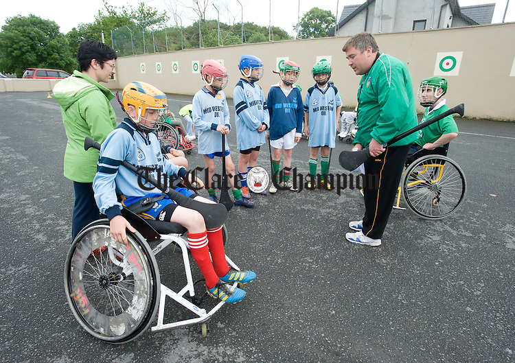 Dave Fitzgerald of Treaty Warriors outlines the rules to local hurlers  before taking part in an exhibition of wheelchair hurling during the Move Smart week held at Clooney-Quin Camogie club. Photograph by John Kelly.
