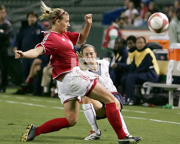 Leslie Osborne has her cross blocked by Melanie Booth. USA captured the 2006 Gold Cup at Home Depot stadium in Carson, California on November 26 2006 thanks to a penalty kick call by the referee with only seconds remaining in the last period of overtime. With the penalty kick score USA beat Canada 2-1.