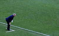 Argentina coach Alejandro Sabella with his hands on his knees on the touchline