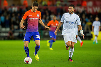 ( L-R ) John Stones of Manchester City and Borja Gonzalez of Swansea City  in action during the EFL Cup Third Round Premier match between Swansea City and Manchester City at The Liberty Stadium. Wednesday 21 September 2016
