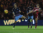 Cristhian Stuani of Middlesbrough striking the ball passed Rhoys Wiggins of Sheffield Wednesday - Sky Bet Championship - Middlesbrough vs Sheffield Wednesday - Riverside Stadium - Middlesbrough - England - 28th of December 2015 - Picture Jamie Tyerman/Sportimage