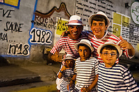 A Brazilian family, all wearing striped t-shirts, take part in the Carnival parade in the favela of Rocinha, Rio de Janeiro, Brazil, 20 February 2012. Rocinha, the largest shanty town in Brazil and one of the most developed in Latin America, has its own samba school called GRES Academicos da Rocinha. The Rocinha samba school is very loyal to its neighborhood. Throughout the year, the entire community actively participate in rehearsals, culture events and parades related to the carnival.