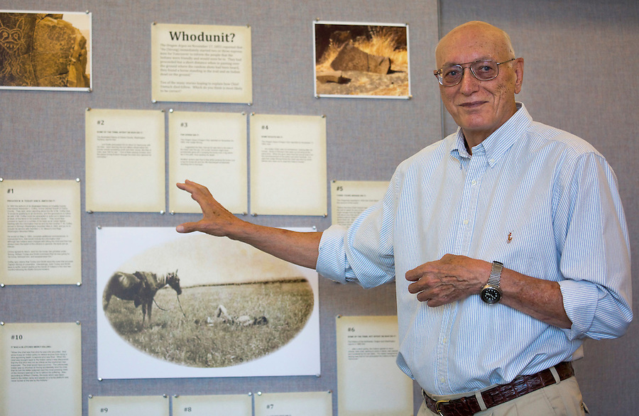 Don Higgins points to a feature on display talks about the latest annual Battle Ground History Mystery in Battle Ground Friday September 9, 2016. Photo by Natalie Behring)