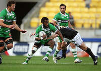 Manawatu's Tomasi Cama steps inside Ged Robinson. Air NZ Cup - Wellington Lions v Manawatu Turbos at Westpac Stadium, Wellington, New Zealand. Saturday 3 October 2009. Photo: Dave Lintott / lintottphoto.co.nz