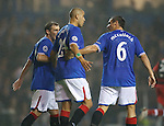 Lee McCulloch and Kevin Thomson have angry words with Madjid Bougherra after defensive blunder