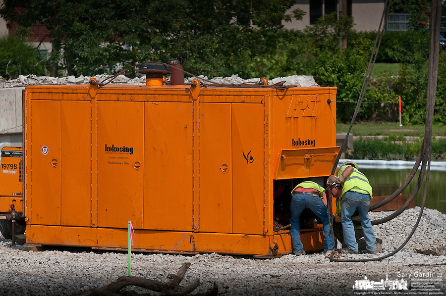 Hydraulic pump installed at Main Street Bridge to drive steel for coffer dam.