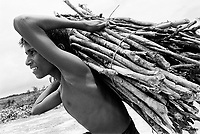 Most Rohingya in the Kutupalong Makeshift Camp cannot find work.  Rohingya hike miles into the forest to collect firewood that they then sell at local markets.  Locals constantly harass the women and police often arrest Rohingya men for taking wood from the forest. (2009)