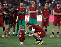 Calcio, Serie A: Roma, stadio Olimpico, 28 maggio 2017.<br /> AS Roma's Francesco Totti with his daughter Isabela during a ceremony to celebrate his last match with AS Roma after the Italian Serie A football match between AS Roma and Genoa at Rome's Olympic stadium, May 28, 2017.<br /> Francesco Totti's final match with Roma after a 25-season career with his hometown club.<br /> UPDATE IMAGES PRESS/Isabella Bonotto