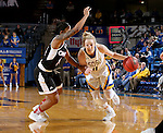 BROOKINGS, SD - JANUARY 7:  Madison Guebert #11 from South Dakota State drives against the defense of Marissa Preston #14 from the University of Nebraska Omaha during their game Saturday afternoon at Frost Arena in Brookings. (Dave Eggen/Inertia)