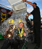 Feb 28, 2016; Chandler, AZ, USA; NHRA top fuel driver Leah Pritchett is doused with a cooler full of ice water as she celebrates after winning the Carquest Nationals at Wild Horse Pass Motorsports Park. Mandatory Credit: Mark J. Rebilas-USA TODAY Sports