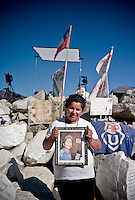 Copiapo, Chile oct 2010. Familys of the 33 miners trapped inside the mines San Jose waiting for the last hrs before the rescue. Mother of Jumy Sanchez (19) the youngest miner trapped inside.