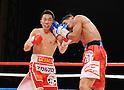 (L-R) Takahiro Aou (JPN), Terdsak Kokietgym (THA),.APRIL 6, 2012 - Boxing :.Terdsak Kokietgym of Thailand hits Takahiro Aou of Japan during the WBC super featherweight title bout at Tokyo International Forum in Tokyo, Japan. (Photo by Mikio Nakai/AFLO)