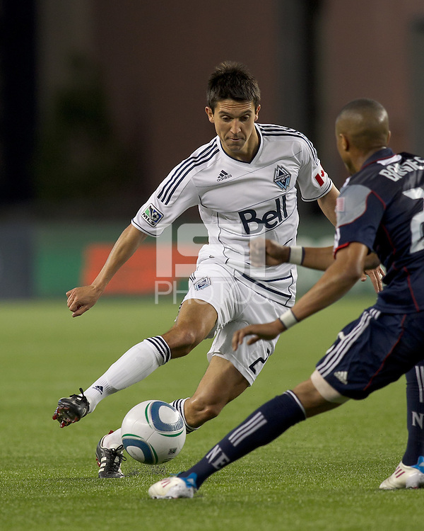 Vancouver Whitecaps FC midfielder Shea Salinas (22) on the attack. In a Major League Soccer (MLS) match, the New England Revolution defeated the Vancouver Whitecaps FC, 1-0, at Gillette Stadium on May14, 2011.