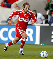 Chicago Fire midfielder Justin Mapp dribbles the ball toward the FC Dallas goal.  FC Dallas defeated the Chicago Fire 2-1 at Toyota Park in Bridgeview, IL on May 17, 2007.