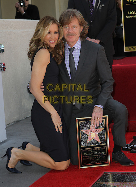 Felictiy Huffman And William H. Macy.Felictiy Huffman And William H. Macy Hollywood Walk Of Fame Induction Ceremony Held At On the Walk of Fame, Hollywood, California, USA.  .March 7th, 2012.full length moustache mustache facial hair married husband wife black suit dress suit kneeling .CAP/ADM/KB.©Kevan Brooks/AdMedia/Capital Pictures.