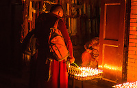 Kathmandu Nepal selling lighting butter candles to be lit for prayers in the early morning at the Boudhanath Stupa Buddhism  9