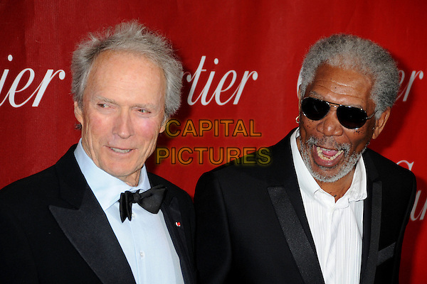 CLINT EASTWOOD & MORGAN FREEMAN.Palm Springs International Film Festival Awards Gala 2010 held at the Palm Springs Convention Center, Palm Springs, California, USA, .5th January 2010..portrait headshot  bow tie blue shirt tux tuxedo white shirt black suit sunglasses beard facial hair mouth open .CAP/ADM/BP.©Byron Purvis/AdMedia/Capital Pictures.