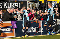 Michael Harriman of Wycombe Wanderers (19) celebrates scoring the opening goal against Mansfield Town during the Sky Bet League 2 match between Wycombe Wanderers and Mansfield Town at Adams Park, High Wycombe, England on 25 March 2016. Photo by David Horn.