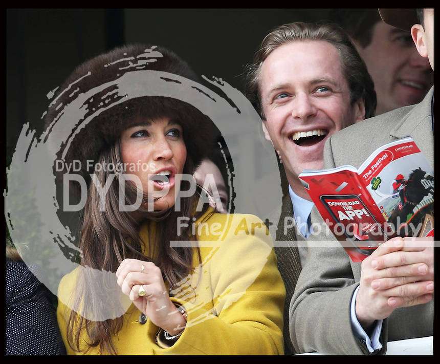 Pippa Middleton watches the second race at the Cheltenham Festival, Thursday, 14th  March 2013.  Photo by: Stephen Lock / i-Images / DyD Fotografos