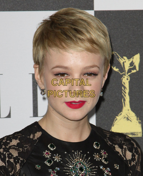 CAREY MULLIGAN .25th Annual Film Independent Spirit Awards held At The Nokia LA Live, Los Angeles, California, USA,.March 5th, 2010 ..arrivals Indie Spirit  portrait headshot black dress lace beaded jewelled red lipstick make-up earrings cropped crop short hair embellished jewel encrusted .CAP/ADM/KB.©Kevan Brooks/Admedia/Capital Pictures