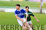 Shannon Rangers, Michael Foley looks for a team mate in a hurry knowing St Brendans Andrew Barry is closing him down.