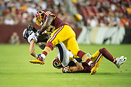 Landover, MD - August 24, 2018: Denver Broncos tight end Matt LaCosse (83) is hit hard by Washington Redskins defensive back Troy Apke (30) and Washington Redskins defensive end Phillip Taylor (99) during preseason game between the Denver Broncos and Washington Redskins at FedEx Field in Landover, MD. The Broncos defeat the Redskins 29-17. (Photo by Phillip Peters/Media Images International)