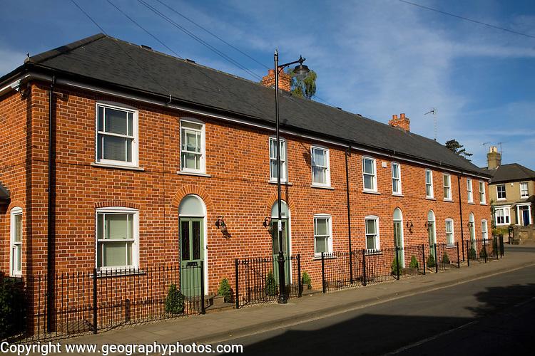 Modern red brick terraced housing in traditional style, St John's Street, Woodbridge, Suffolk, England