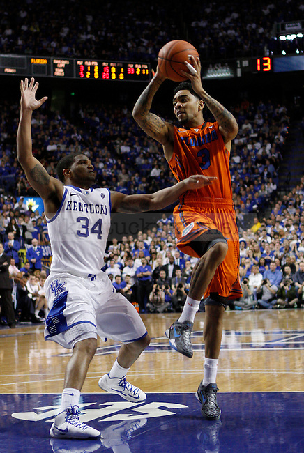UK's Julius Mays does his best to get back and defend Florida's Mike Rosario. in Lexington, Ky., on Sunday, March, 10, 2013. Photo by James Holt   Staff
