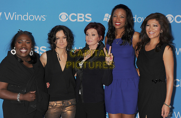 Sheryl Underwood, Sara Gilbert, Sharon Osbourne, Aisha Tyler, Julie Chen.CBS 2012 Fall Premiere Party Held at At Greystone Manor, West Hollywood, California, USA..September 18th, 2012.half length suit blazer trousers hand arm blue dress gold bronze jeans hand v peace sign.CAP/ROT/TM.©Tony Michaels/Roth Stock/Capital Pictures