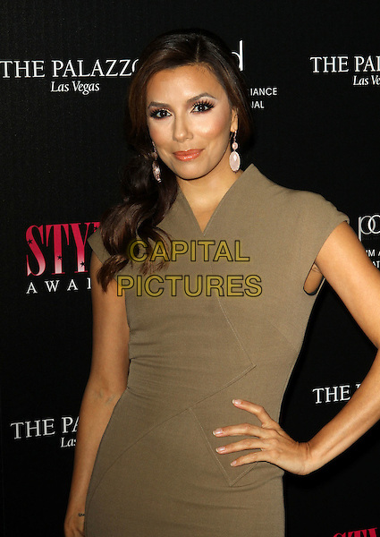 Eva Longoria.2011 Hollywood Style Awards Sponsored By Smashbox, The Palazzo Las Vegas And Palladium Jewelry.Held At Smashbox Studios, West Hollywood, California, USA..November 13th, 2011.half length dress green khaki hand on hip  .CAP/ADM/KB.©Kevan Brooks/AdMedia/Capital Pictures.