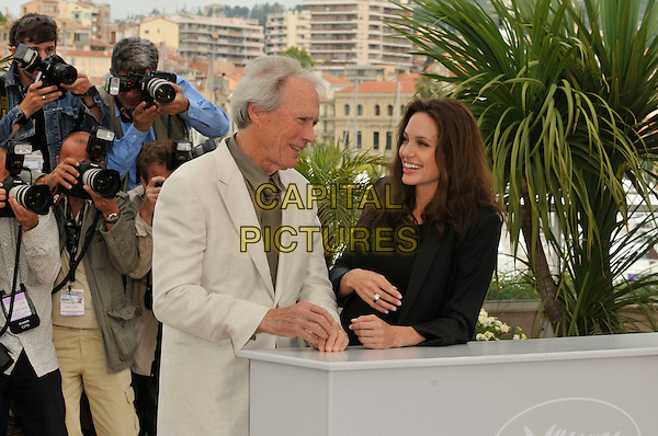 "CLINT EASTWOOD & ANGELINA JOLIE.""The Exchange"" ( formerly titled ""Changeling"" ) photocall at Palais de Festival during the 61st Cannes International Film Festival, Cannes, France. .20th May 2008 .half length black beige cream jacket hand profile top .CAP/PL.©Phil Loftus/Capital Pictures."