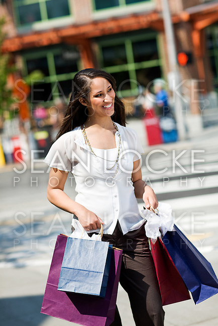 Couple going shopping in a colorful urban area.