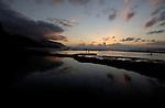 Sea pool and the Atlantic at dusk, Playa del piloto, El Hierro,Canary Islands, Spain.